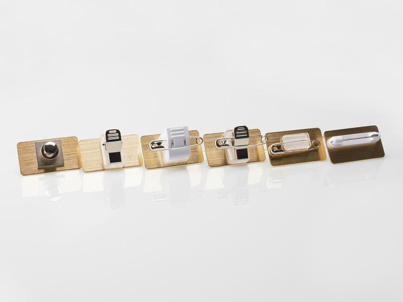 留め具(左から):タイタック、ワニ口ピン、回転両用ピン、安全ピン、フックピン
